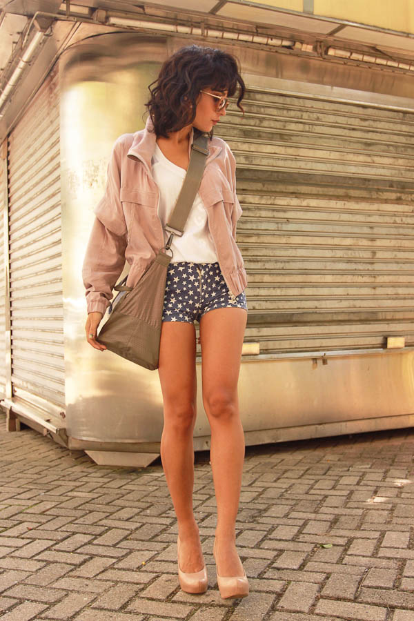 Instinto De Vestir Is Wearing Blue Mini Shorts With Stars, And Adidas Jacket And Bag