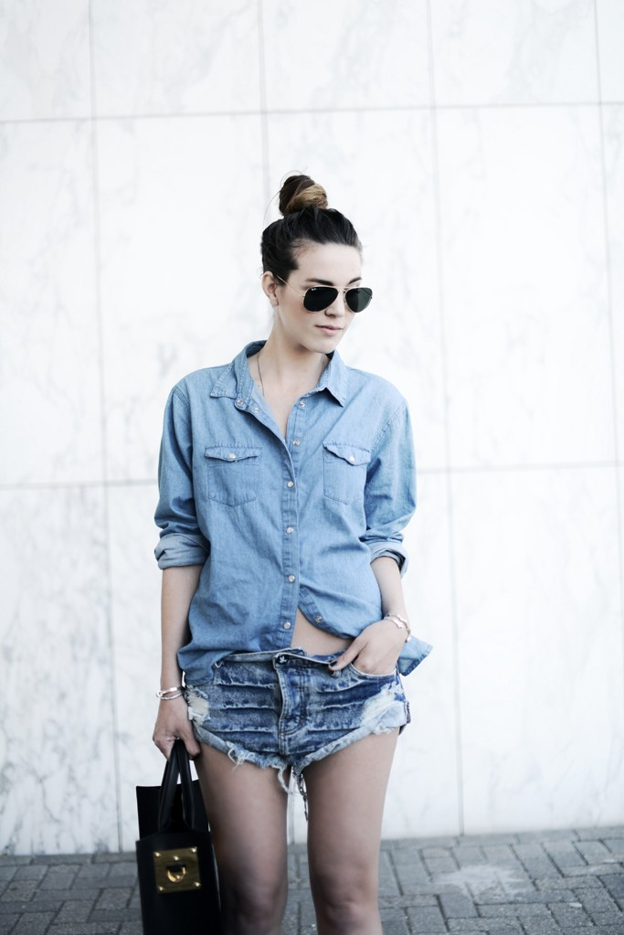 Cindy Van Der Heyden Is Wearing Denim Shorts From One Teaspoon, Denim Top From Primark And Sunglasses From Rayban