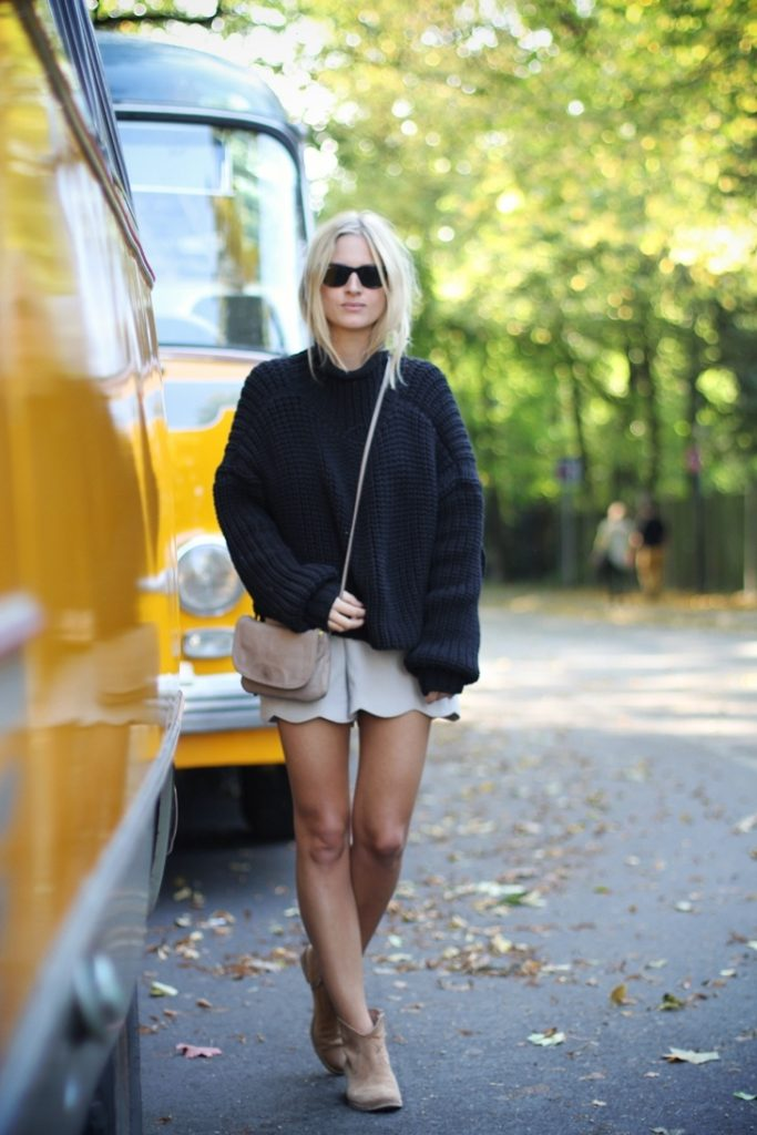 Mija Is Wearing An Oversized Knit Jumper From Alexander Wand, Shorts From Nishe, Boots From Akira And A Bag From COS