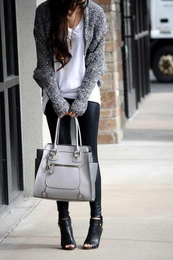 Cleverly Yours Is Wearing A White T-Shirt From Goodhyou, Grey Speckled Cardigan. Albion Fit Liquid Leggings, And The Bag Is From London Fog