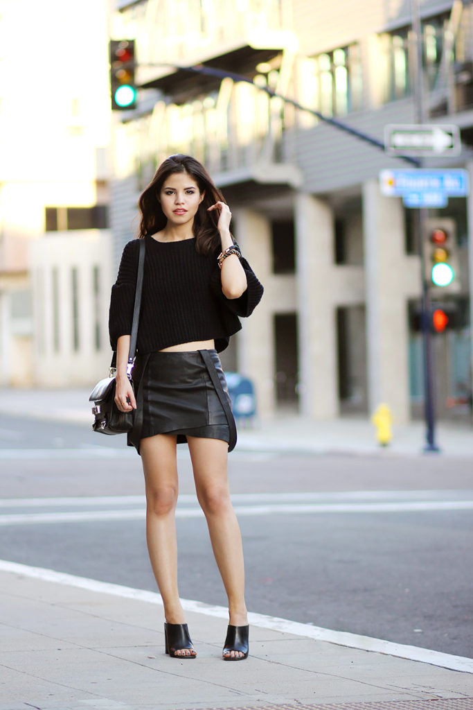 Fake Leather Wearing Leather Mini Skirt From Maje, Oversized Crop Top Sweater From Oasap, Proenza Schouler Bag And Mules From Zara