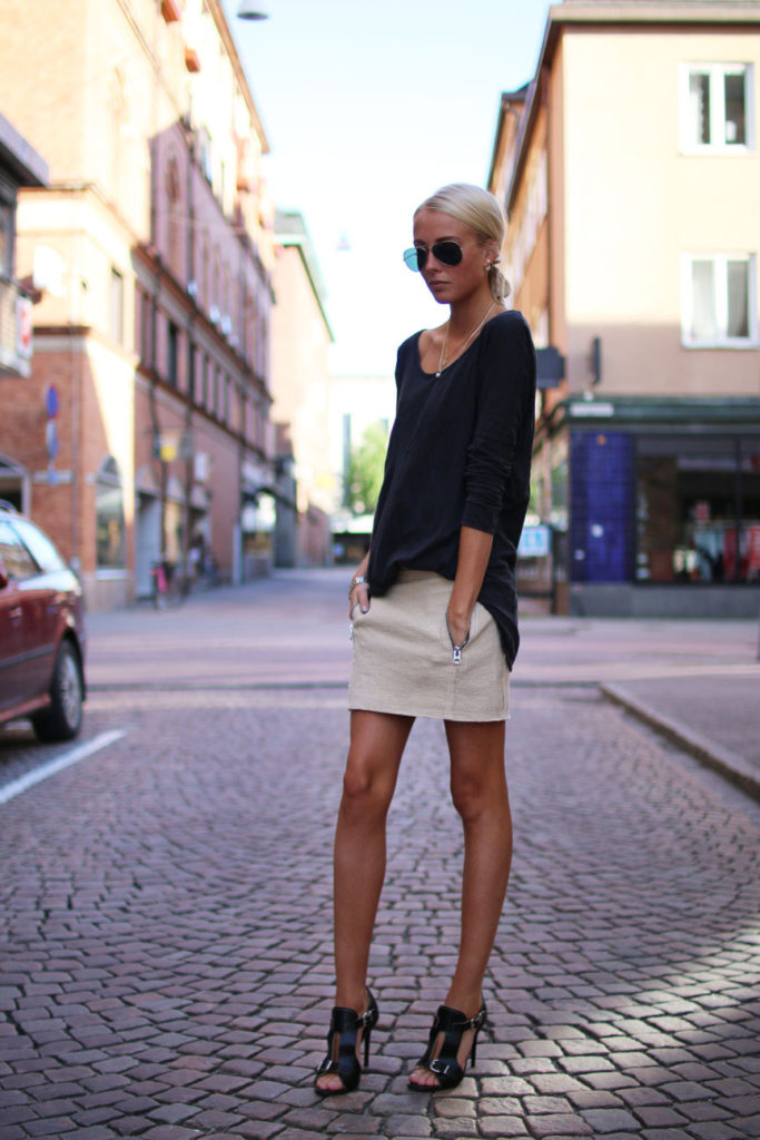 Ellen Claesson Is Wearing A Beige Skirt And Shoes From Acne And The Black Top Is From Zara
