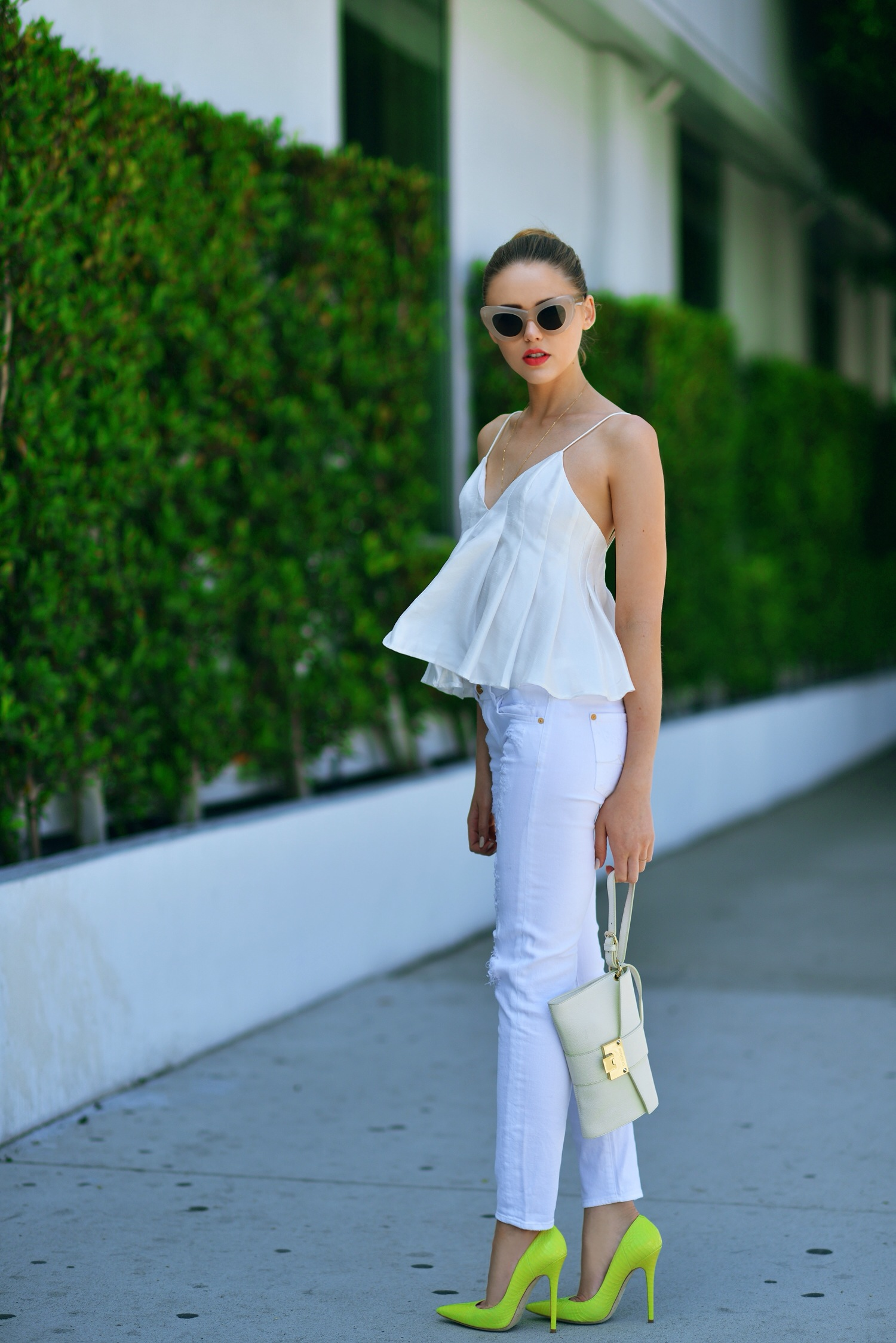 Kayture Is Wearing White Top From Finders Keepers, White Jeans From 7 For All Mankind, Lime Coloured Shoes And Clutch From Jimmy Choo, Sunglasses From Céline