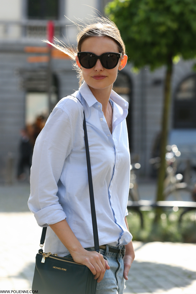 Paulien Is Wearing A Light Blue Shirt From Good Genes, Belt From IKKS, Distressed Denim Jeans And Bag From Michael Kors And Sunglasses From Celine