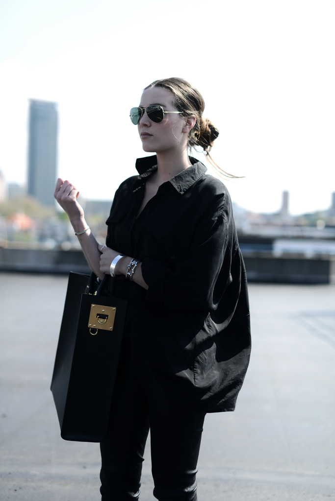 Cindy Van Der Heyden All In Black Oversized Shirt And Leather trousers From Gestuz, Tote Bag From Sophie Hulme And Sunglasses From RayBan
