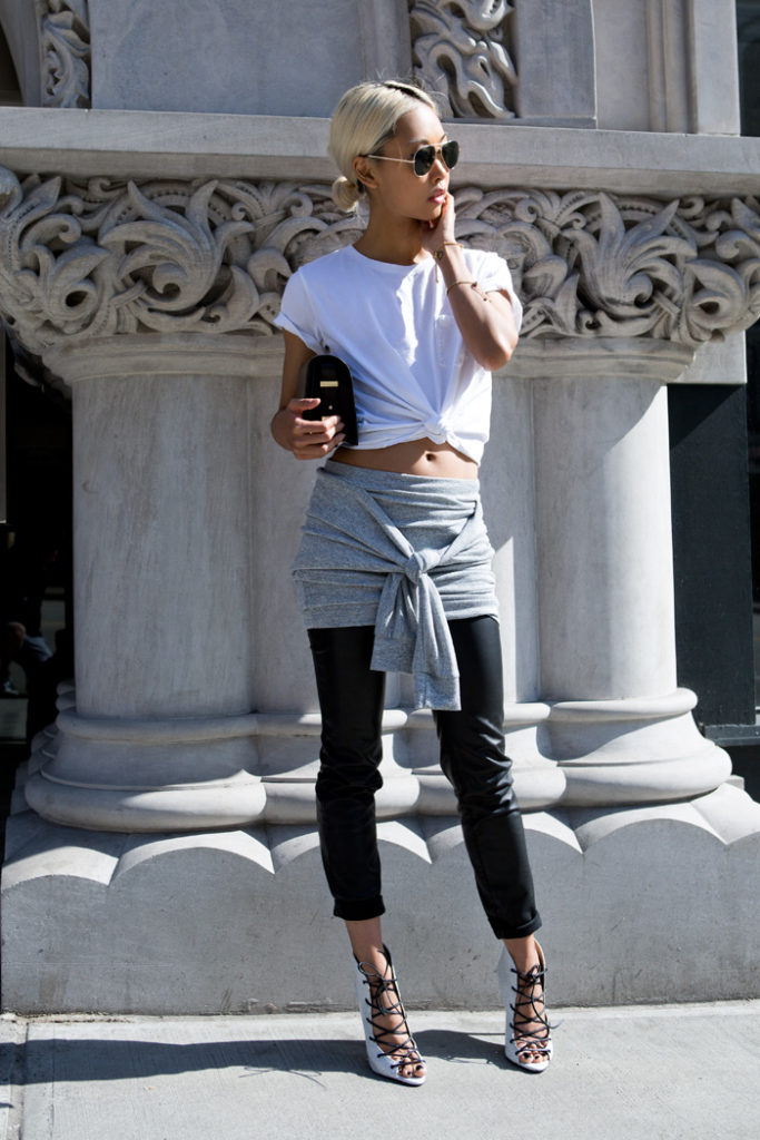 Vanessa Hong Is Wearing A T-Shirt From Everlane, Grey Knotted Skirt From THP, Shoes From The Mode Collective And Leather Pants From Zara