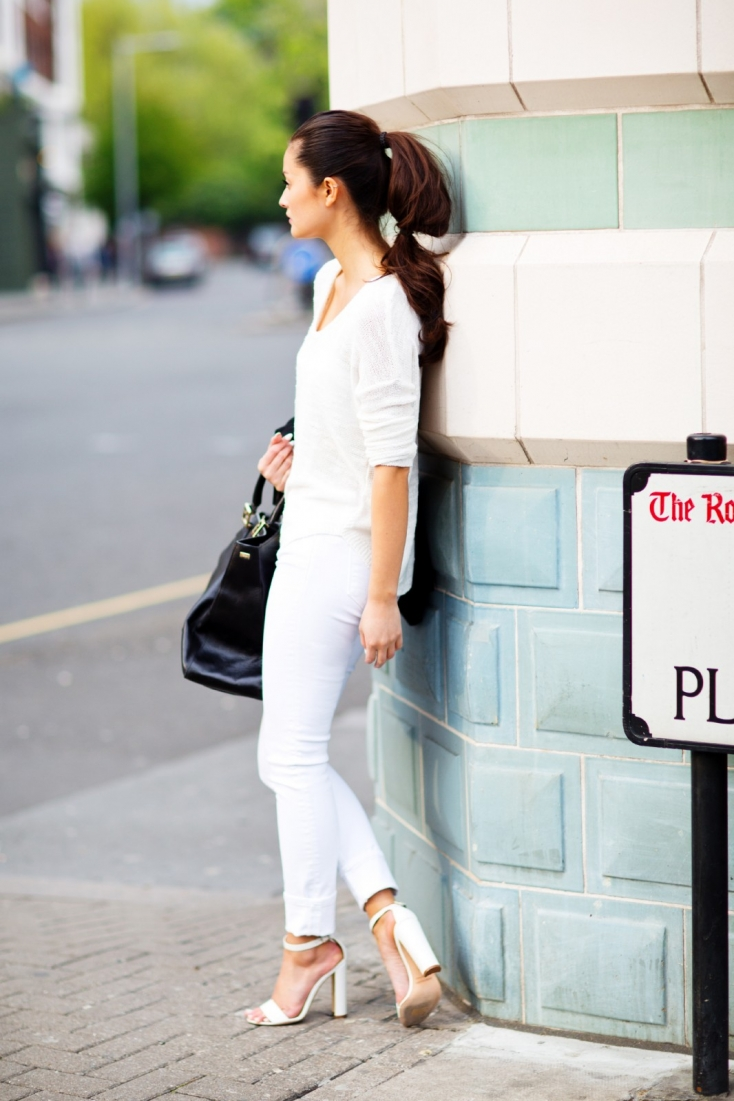Peony Lim Is Wearing All White. Shoes From Manolo Blahnik, Jeans From J Brand, Knit Top From Zara And A Fendi Bag