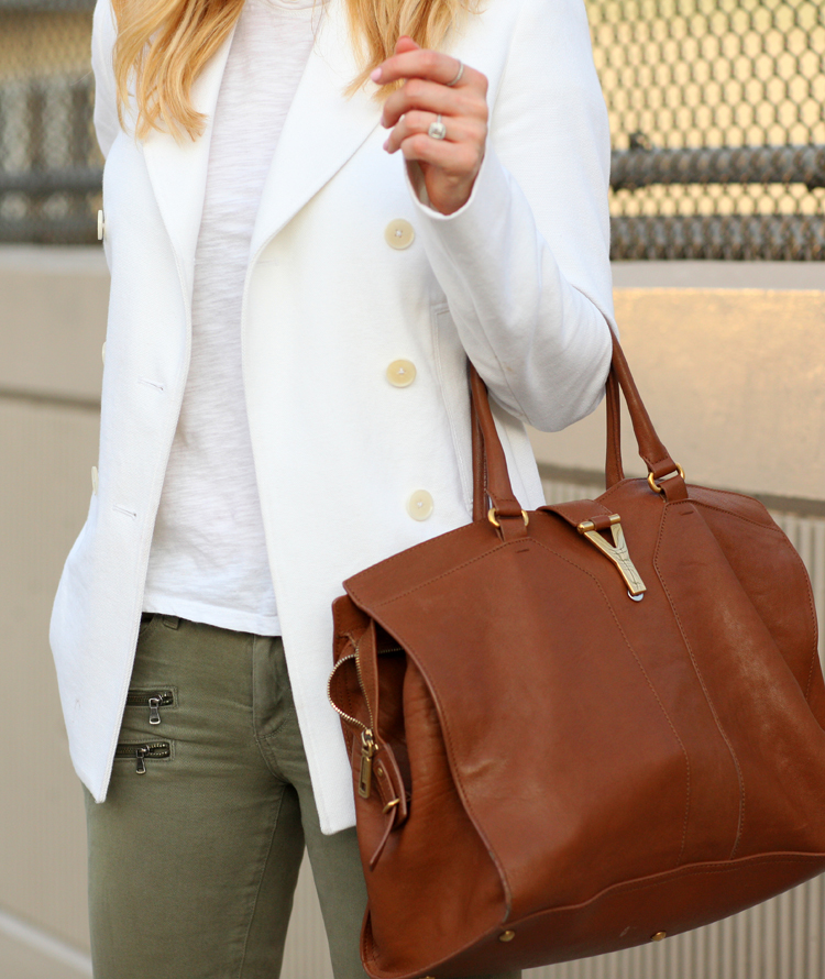 Helena Glazer Is Wearing A White Blazer From Joseph, Jeans From Paige Denim, T-Shirt From Vince, And Handbag From Saint Laurent