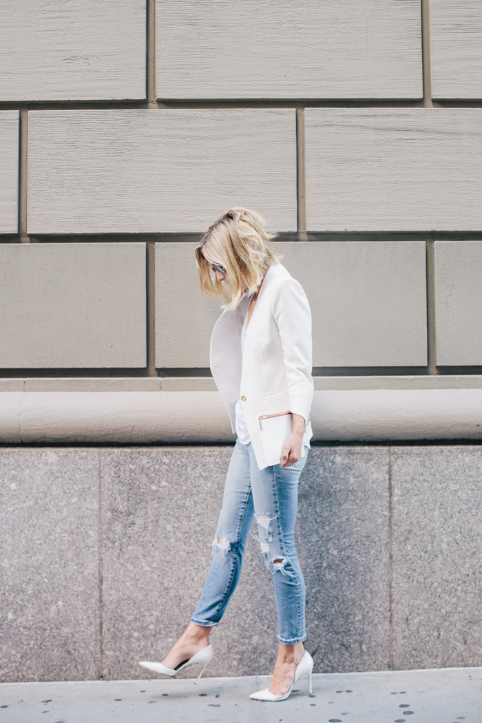 Jacey Duprie is wearing distressed a white blazer from Helmut Lang, jeans from Joe's Jeans and white shoes from Manolo Blahnik