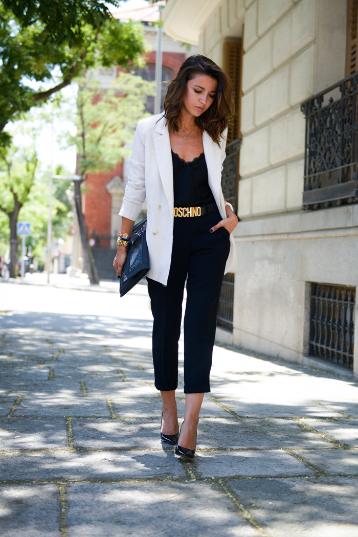 Alexandra Pereira is wearing a black lace top from The Amity Company, trousers from Zara, belt from Moschino, shoes from Michael Kors and a white blazer from Storets