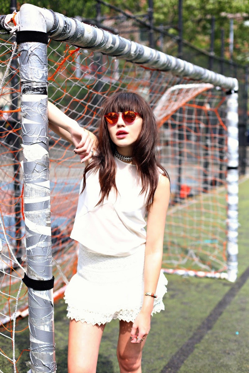 Natalie Suarez Sporting A White-On-White Look Wearing Top And Lace Skirt From H&M, Sunglasses From Spektre