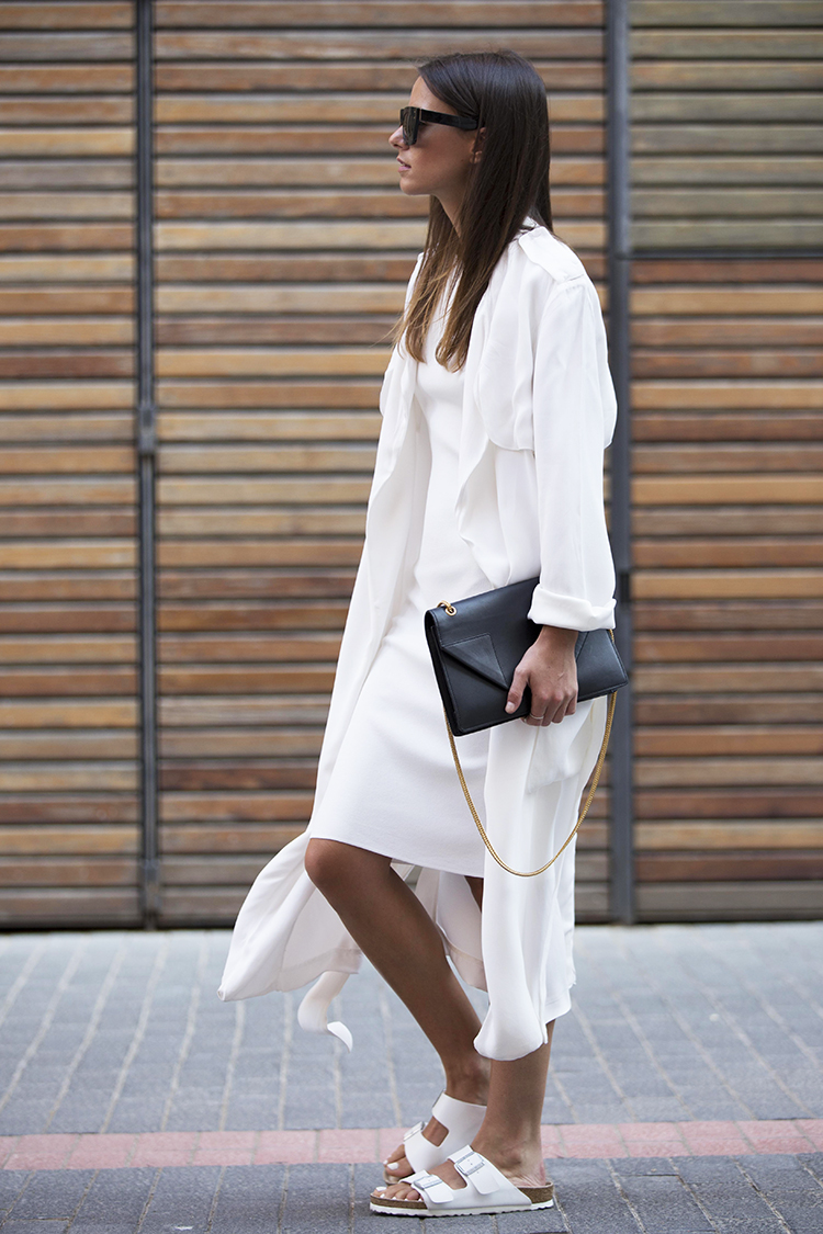 Zina Charkoplia is wearing all white on white bag from Saint Laurent, dress and trench coat both from Zara, sunglasses from & Other Stories and sandals from Birkenstock
