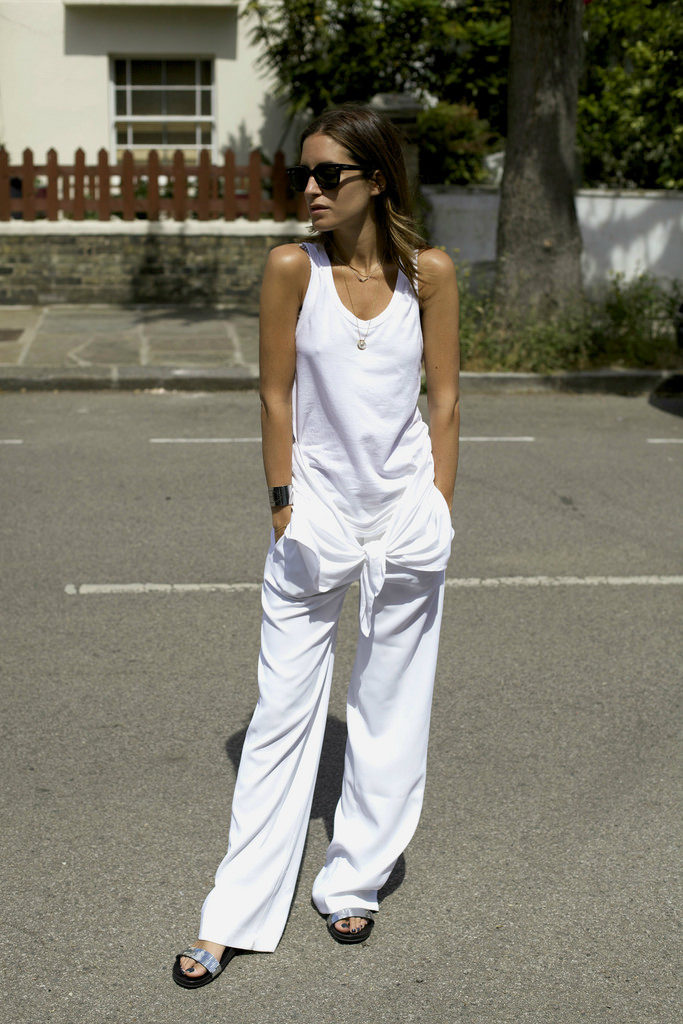 Gala Gonzalez is wearing a all white top and trousers from Zara, shoes from Pedro Garcia and sunglasses from Rayban