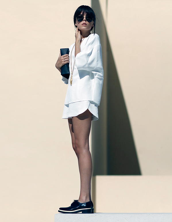 Evangelie Smyrniotaki Is Wearing White On White Top And Shorts From Stella McCartney Sunglasses From Linda Farrow And Shoes From Acne