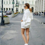 Julietta From Maffashion Wearing The White-On-White Fashion Trend With Backpack, Jacket And Sunglasses From Bershka, And The Skirt Is From Primark