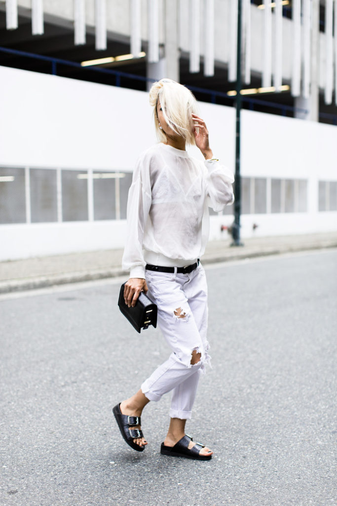 Vanessa Hong is wearing white on white jeans from siwy, white top and senso sandals from Birkenstock