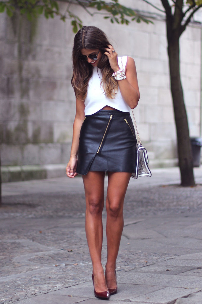 Natalia Cabezas is wearing an asymmetrical leather mini skirt