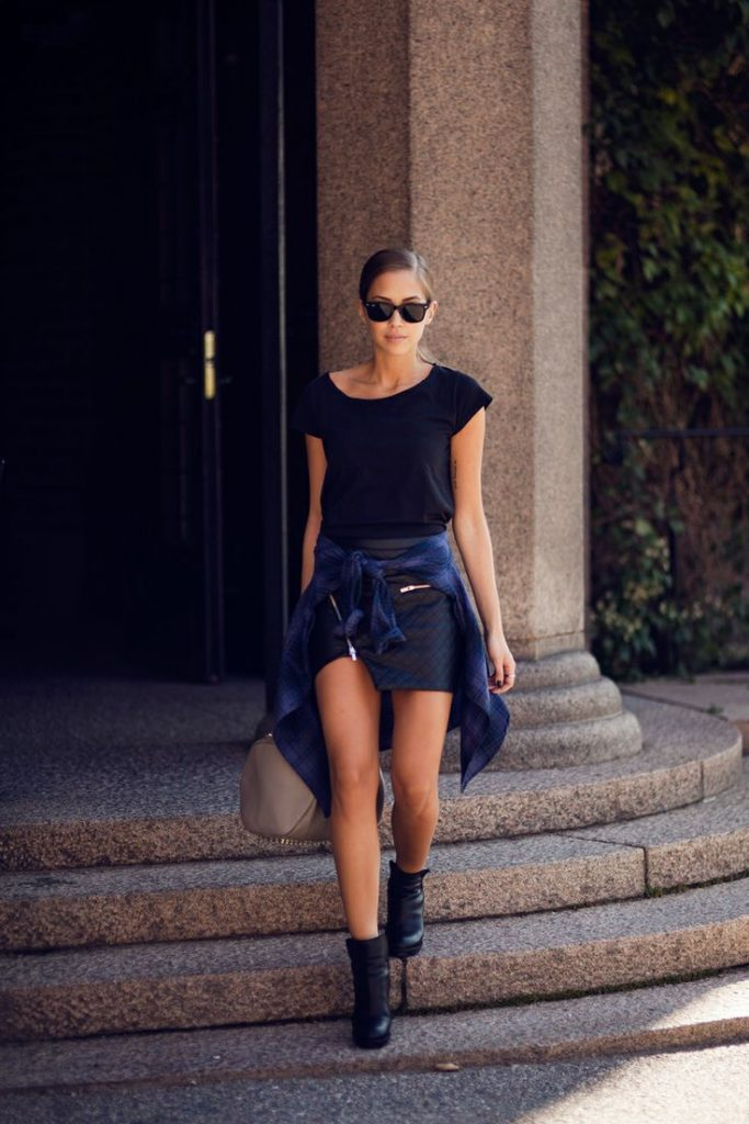 Kenza Zouiten is wearing Black leather skirt from Ivyrevel, T-shirt and boots from Acne, shirt from Gina Tricot and a rocco bag from Alexander Wang