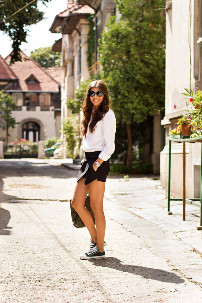 Larisa Costea is wearing an asymmetrical skirt from Sheinside, boyfriend shirt from ASOS and sneakers from Converse