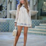 Helena Cave Ramos is wearing a crochet and lace top from A Bad Day, denim shorts from Mango and wedges and handbag from Stradivarius