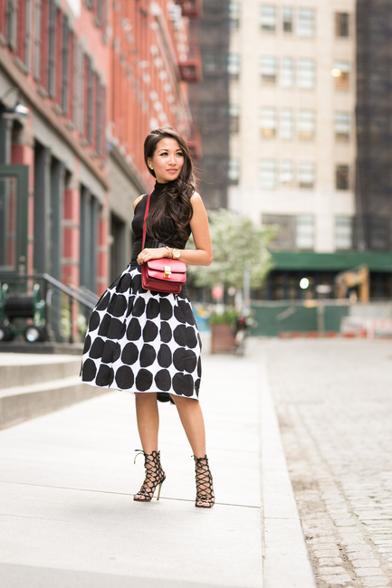 Wendy Nguyen is wearing a black top from ASOS, full skirt from Banana Republic, bag from Celine and shoes from Gianvito Rossi