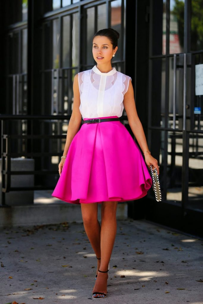 Annabelle Fleur is wearing trim top from Organza, clutch from Kate Spade, shoes from ASOS and a pink full skirt from Cameo