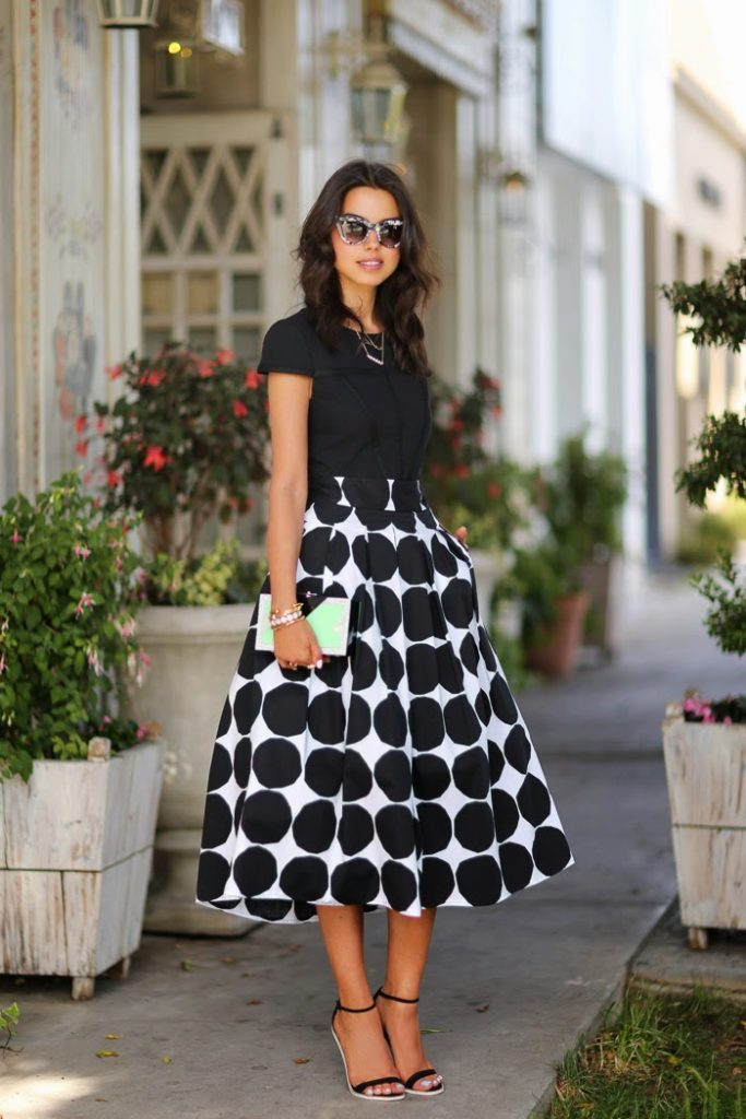 Annabelle Fleur is wearing a polka dot full skirt from Banana Republic, top from Keepsake, sandals and sunglasses from ASOS