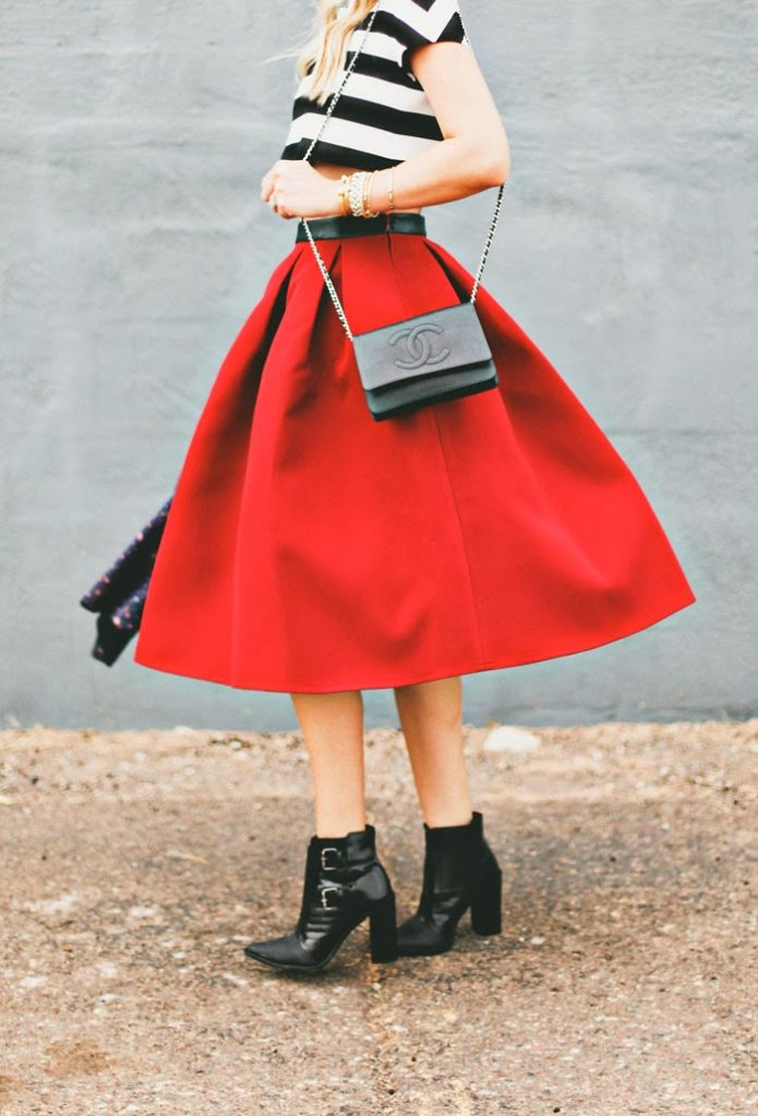 Caitlin Lindquist Is Wearing A Red Full Skirt From ASOS, Crop Top From Maje, Shoes From Tibi And The Bag Is From Chanel