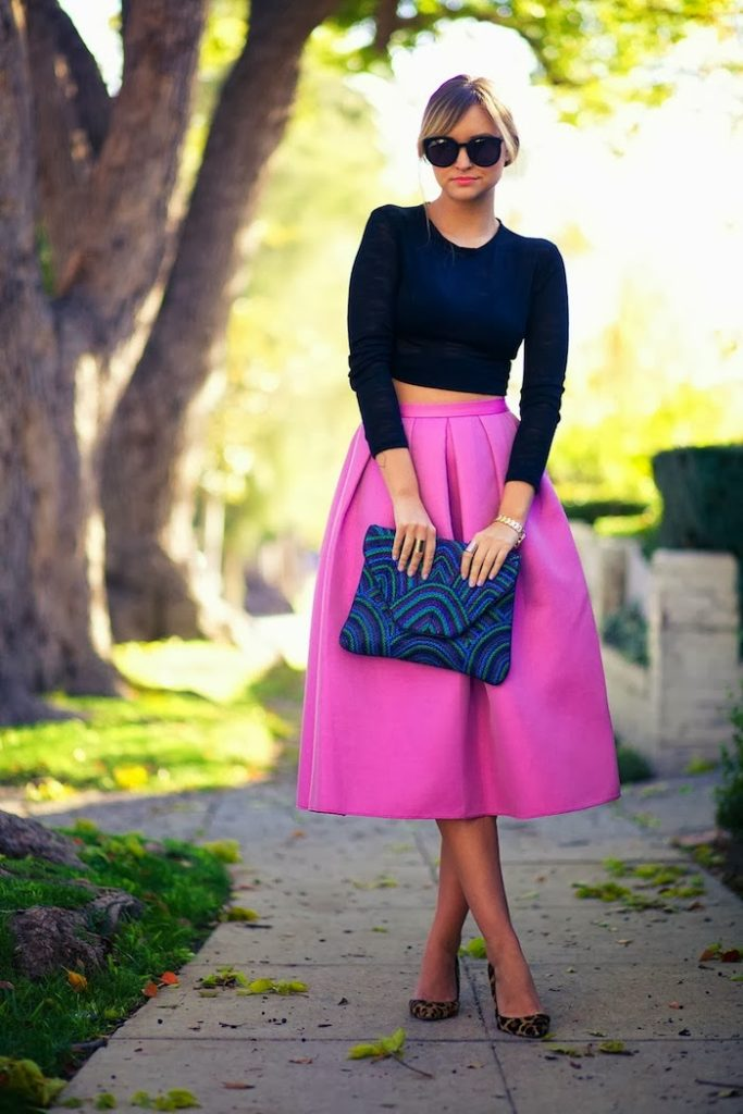 Vanessa Ribeiro Is Wearing A Full Pink Skirt From Tibi, Dark Blue Crop Top From Zara, Leopard Print Shoes From J.Crew, Clutch From Antik Batik, And  Sunglasses From Karen Walker