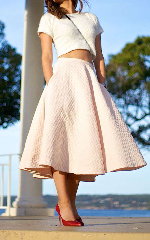 Charlotte Bridgeman is wearing a textured pale pink full skirt from H&M, white top from Showpo and shoes from RMK