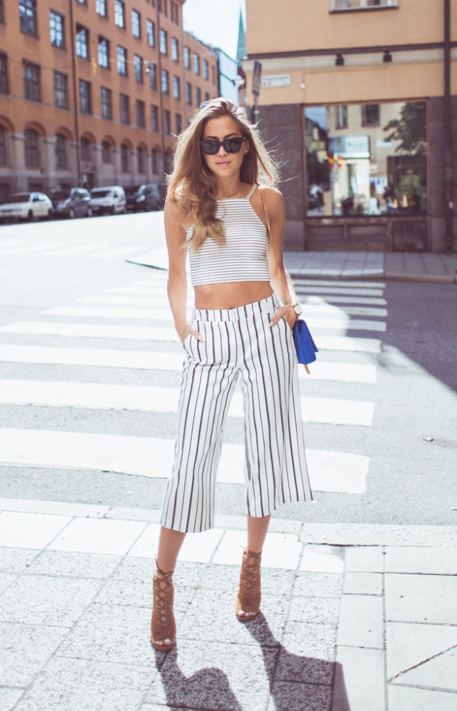 Vertical striped culottes and a horizontal striped crop top. What could be more on point ? Via Kenza Zouiten  Pants/Shoes: River Island, Top: Topshop