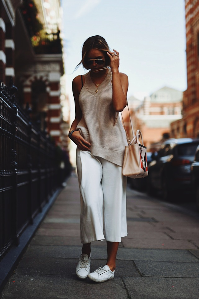 Pair your white culottes and sneakers with a beige top. Via Nina-Victoria Suess Top: All Saints, Culottes: New Look, Shoes: Gant, Bag: Fendi. Culottes Outfits