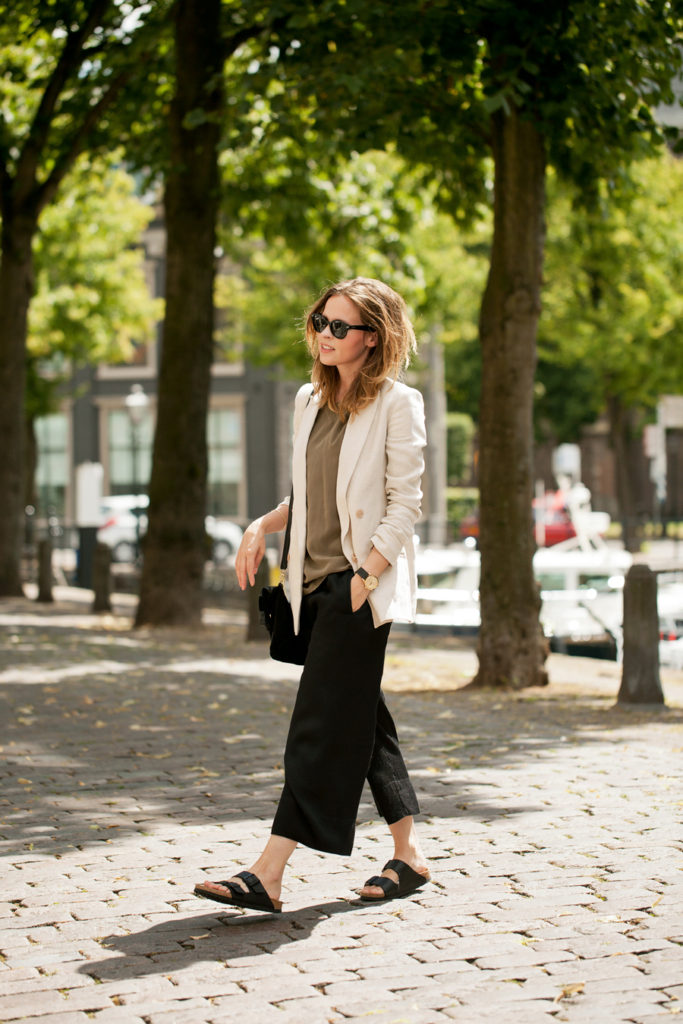 Christine R. is wearing a beige blazer from Massimo Dutti, silk top, culotte shorts from Zara and sandals from Birkenstock
