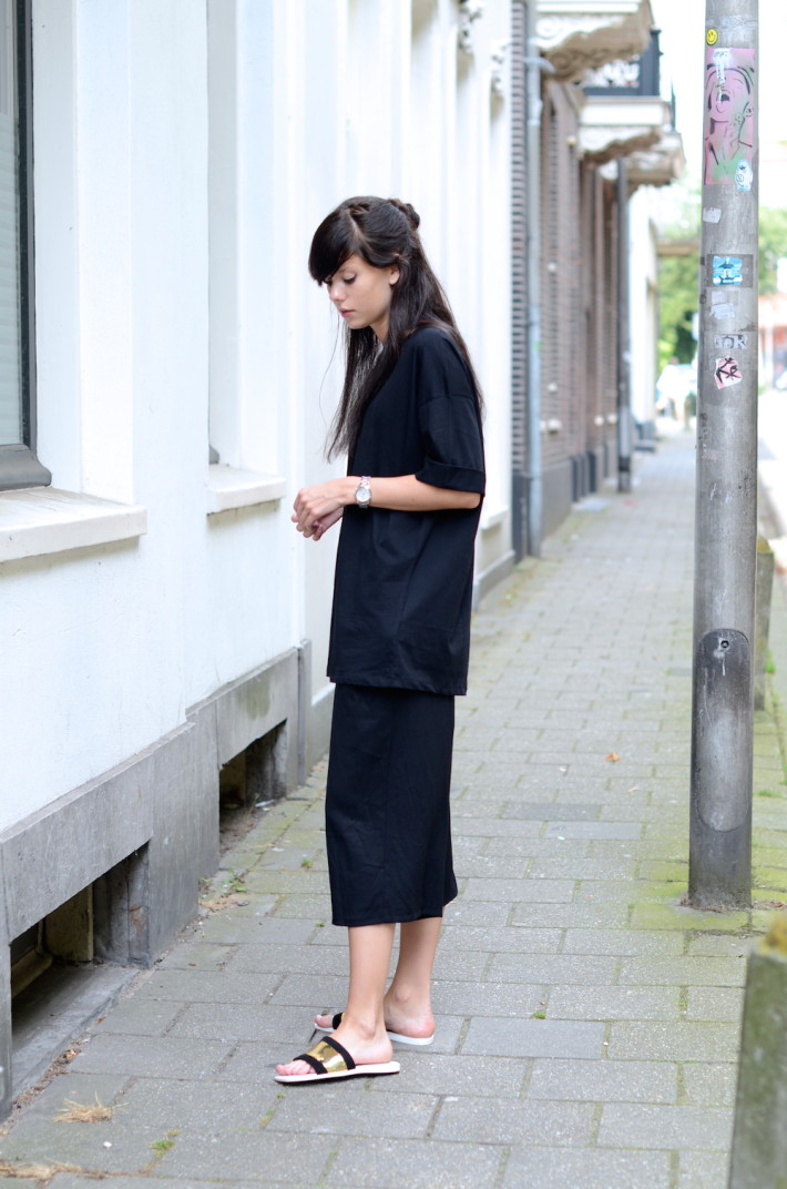Lucy de Boer is wearing culotte shorts and an oversized shirt from ASOS and the sliders are from Zara
