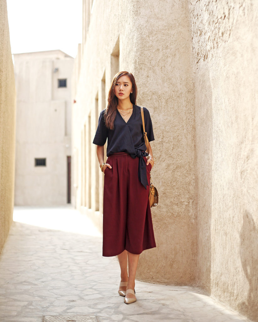 Camille Co is wearing wine red culottes from Topshop
