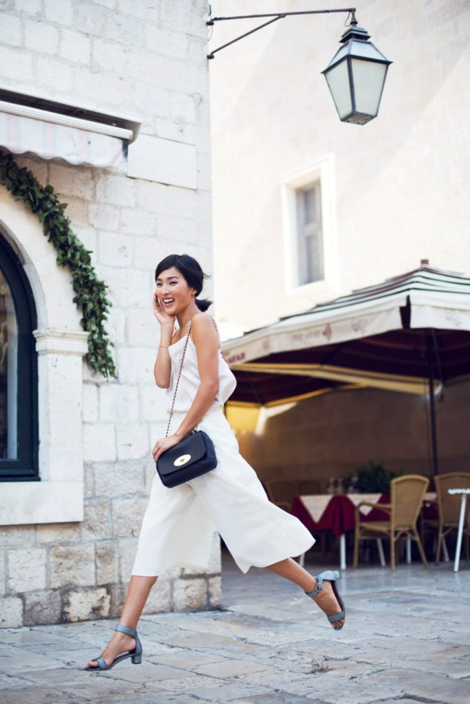 Nicole Warne is wearing all white top and culottes from ASOS, shoes from Chie Mihara and the bag from Mulberry