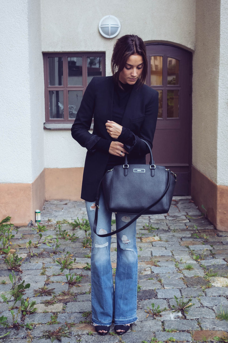 Michaela Deler is wearing a black jacket and jumper from Zara, flared jeans from H&M, bag from DKNY and the shoes are from Zara