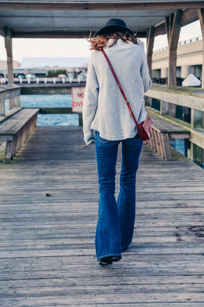 Flared Jeans Trend, 2015: Jess Ann Kirby is wearing flared jeans from Paige Denim