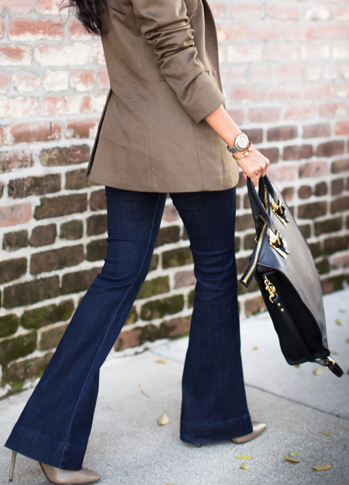 Sheryl Luke is wearing a mid rise slim flare jeans from Express