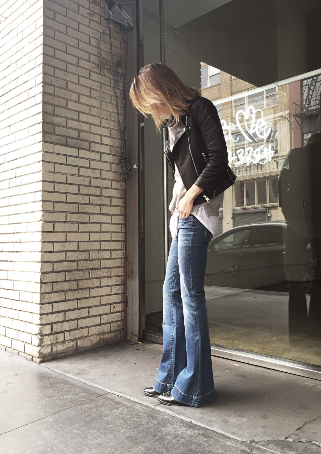 Anine Bing is wearing well worn flare jeans from her own collection