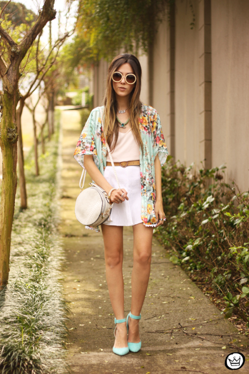 Flávia Desgranges van der Linden is wearing a floral kimono, top and skirt from Turquoise Shop, bag from Amaro and shoes from Haute & Rebellious