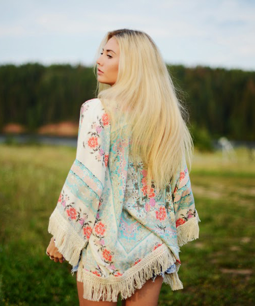 Valeriya Volkova is wearing a floral kimono with tassels from Choies