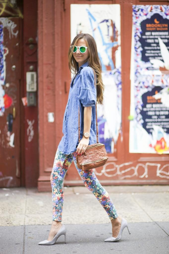 Arielle Nachami is wearing floral leggings from H&M, chambray from Wildfox, Shoes from Manolo Blahnik, bag from Givenchy and the sunglasses are from Illesteva