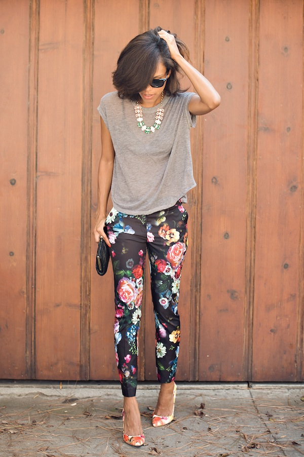 Grasie Mercedes is wearing a grey T-shirt from Urban Outfitters, black floral trousers and floral pumps from Ivanka Trump