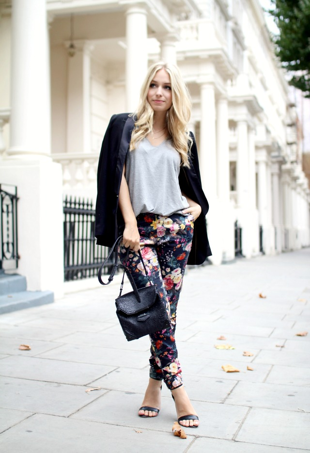 Yara Michels is wearing black tuxedo blazer, grey v-neck tee and floral trousers