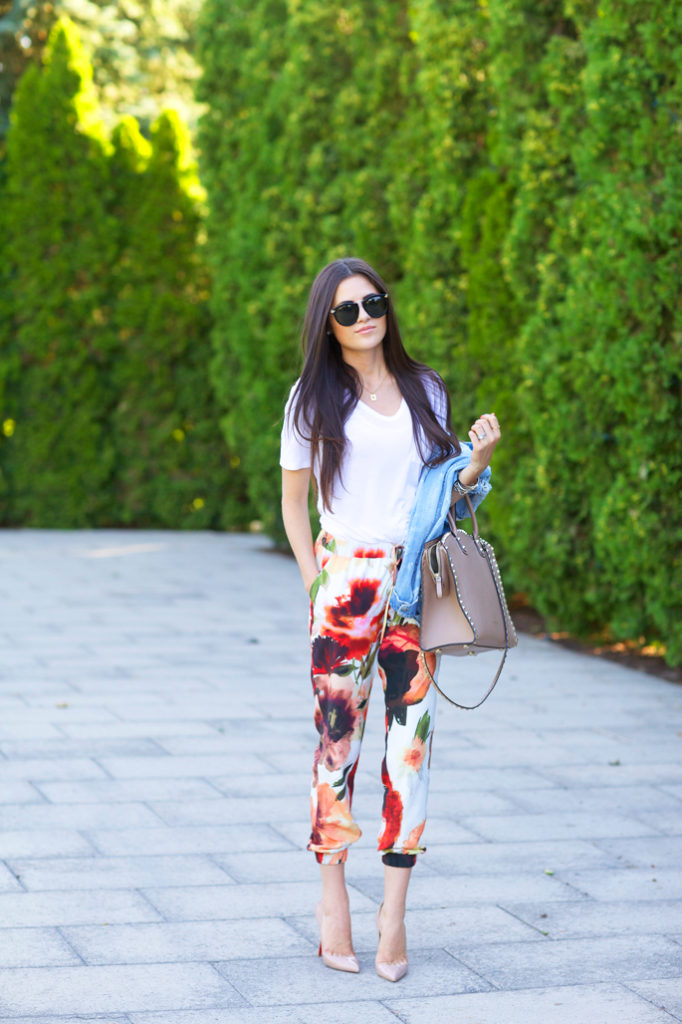 Rachel Parcell is wearing floral silk pant from Nordstrom, white T-shirt from Alexander Wang, bag from Valentino, shoes from Christian Louboutin and sunglasses from Karen Walker