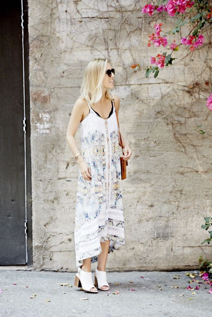Jacey Duprie is wearing a paisley high low dress from Cynthia Vincent and white shoes from Zara