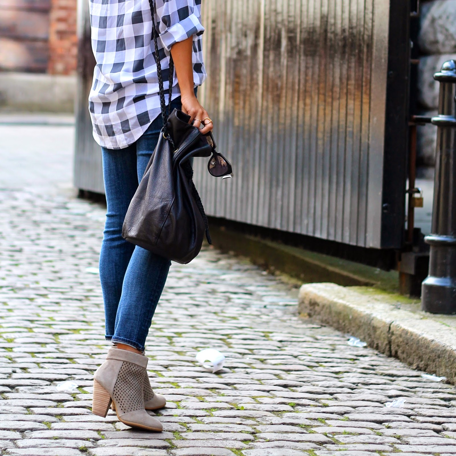 Ashley Torres is wearing jeans from J. Brand, gingham shirt from Equipment and boots and bag from Sole Society