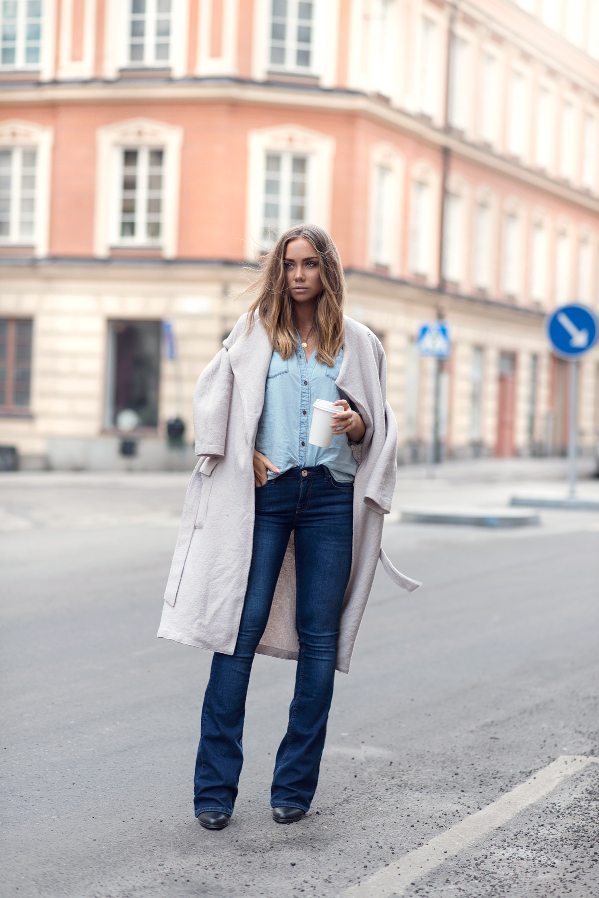 Flared Jeans Outfit Ideas: Lisa Olsson is wearing a pair of denim River Island jeans