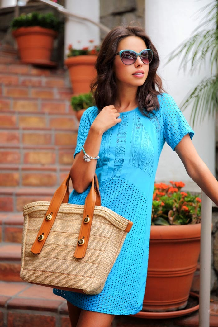 Annabelle Fleur is wearing a cyan mesh dress from Nanette Lepore, sunglasses from IVI Vision Dusky and the bag is from Louis Vuitton